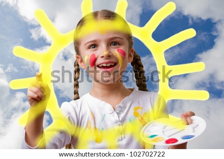 Happy summer - lovely girl painting sun on sky - stock photo
