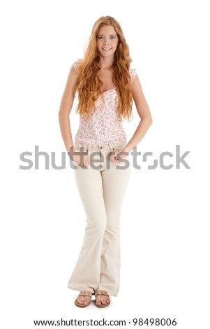 Happy summer portrait of redhead girl with long curly hair, smiling at camera, cutout on white. - stock photo