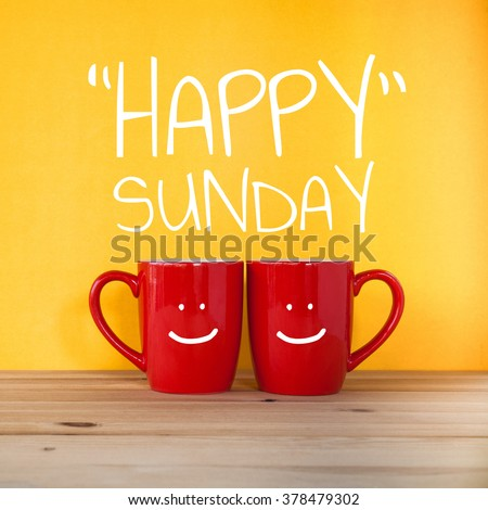 Happy sunday word.Two cups of coffee and stand together to be heart shape on yellow background with smile face on cup. - stock photo