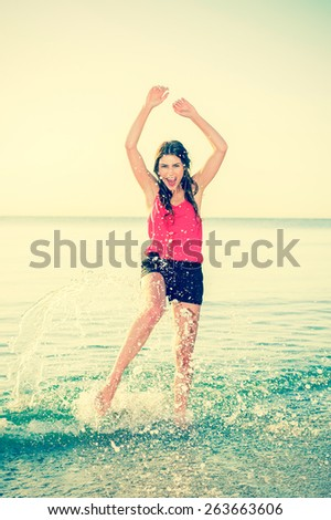 Happy sunshine woman. Girl smiling joyful and friendly on warm sunny summer day under the hot sun on beach. Beautiful  caucasian female bikini model. - stock photo