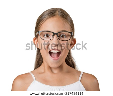 Happy surprise. Closeup portrait teenager girl with glasses shocked wide open mouth eyes jaw drop blown away isolated white background. Human emotion facial expression feeling body language reaction - stock photo