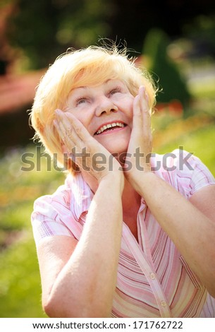 Happy Surprised Glad Grey-Haired Senior Woman Looking Up. Expression - stock photo
