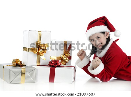 happy surprised little girl with a lot of presents - stock photo