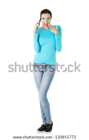 Happy surprised woman with cell phone, isolated on white - stock photo
