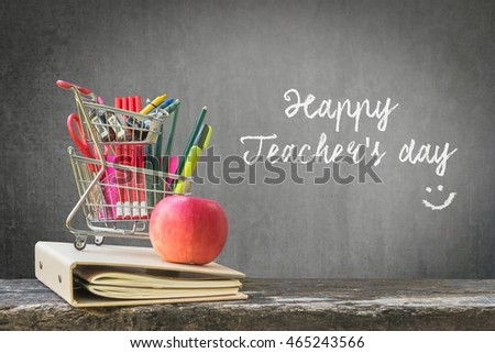 Happy teacher's day concept with freehand text message announcement & smiley face on green chalkboard background: Students sending greeting message to school teachers/ academia on special occasion