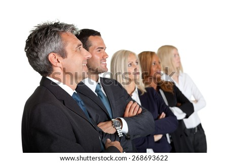 Happy team of business colleagues standing together with hands folded looking away - stock photo