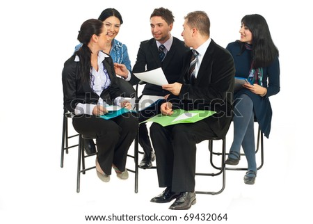 Happy team of five business people sitting on chairs and having funny conversation at seminar isolated on white background
