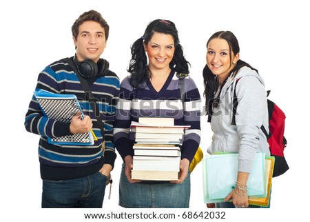 Happy team of three students with books and notebooks standing in a row isolated on white background