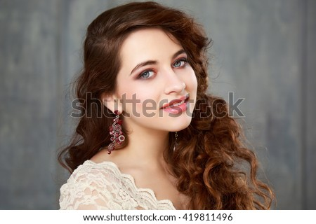 Happy teen girl with prom make-up and hairstyle - stock photo