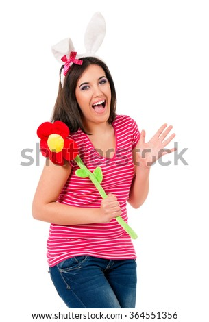 Happy teen girl with white rabbit ears and big flower, isolated on white background - stock photo