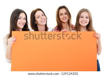 happy teen girls holding big orange empty banner over white