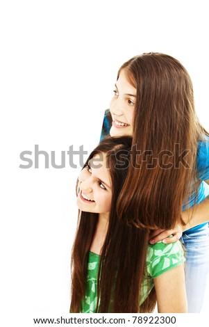 Happy teen girls white blank board - stock photo