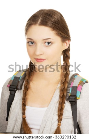 Happy teen woman with backpack.