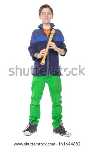 happy teenage boy is holding a flute, isolated on white. - stock photo