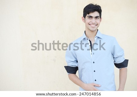 Happy teenage boy posing - stock photo
