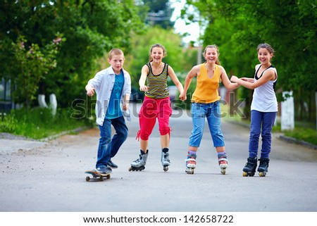 happy teenage friends playing outdoors