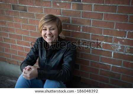 Happy teenage girl hangs out outside school - stock photo