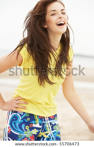 Happy Teenage Girl Having Fun On Beach - stock photo