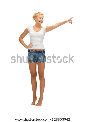 happy teenage girl in blank white t-shirt poining her finger - stock photo
