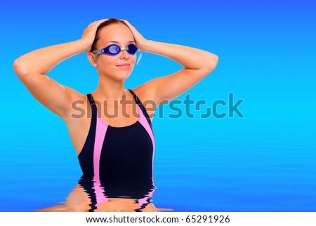 Happy teenage girl in tropical sea - stock photo