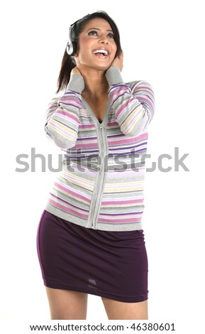 happy teenage girl listening music - stock photo