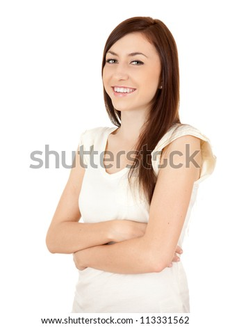happy teenage girl standing with folded arms, white background - stock photo