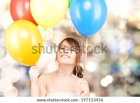 happy teenage girl with balloons over white - stock photo