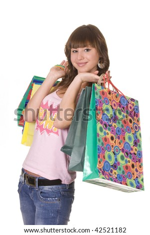 Happy teenage girl with shopping bags - stock photo