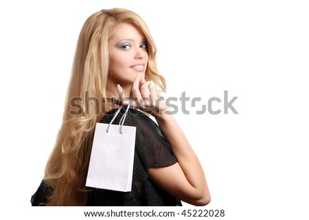 happy teenage girl with small white shopping bag - stock photo