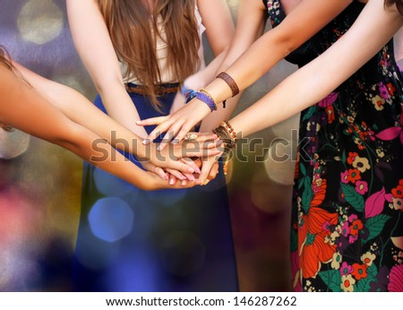 Happy Teenage Group with Hands on Stack. - stock photo