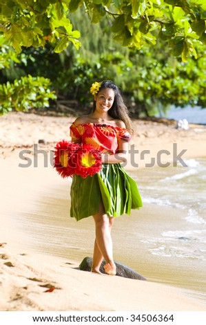 happy teenage hula girl walking on the beach in Kauai Hawaii - stock photo
