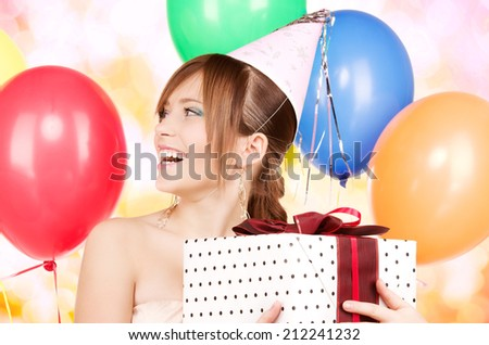 happy teenage party girl with balloons and gift box - stock photo