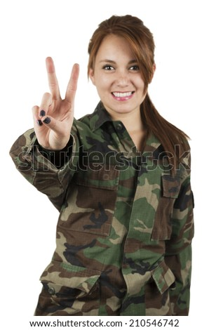 Happy teenage young girl wearing green military jacket gesturing peace sign isolated on white - stock photo