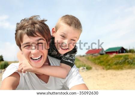 happy teenager and kid - stock photo