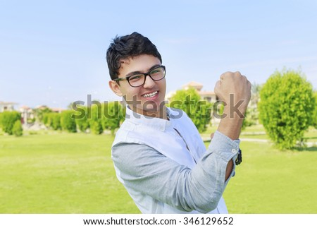 Happy teenager and sign of victory. - stock photo