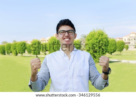 Happy teenager and sign of victory,success. - stock photo