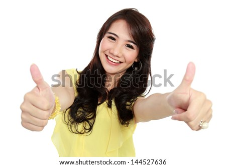 happy teenager girl give you two thumb up - stock photo