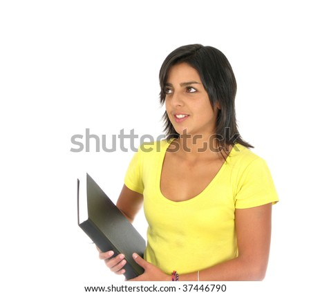 Happy teenager girl with a notebook isolated over white background