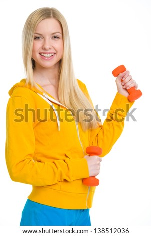 Happy teenager girl with dumbbells