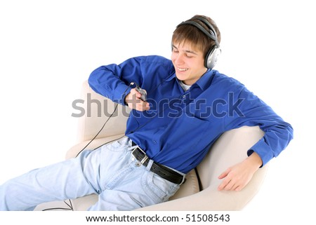 happy teenager in headphones sitting in a chair - stock photo