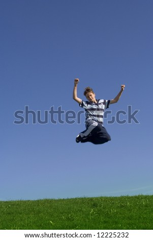 happy teenager jumping - stock photo