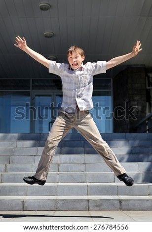 Happy Teenager Jumping on the Landing Steps - stock photo