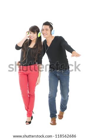 Happy teenagers in headphones moving to the music