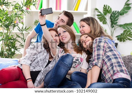 Happy teenagers taking group photo with smartphone - stock photo