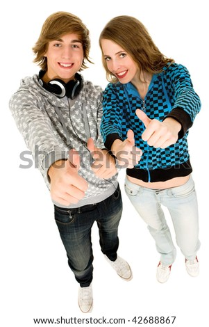 Happy teenagers with thumbs up - stock photo