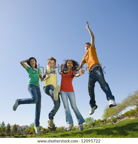 Happy teens jump in air - stock photo
