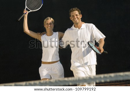 Happy tennis partners celebrating victory