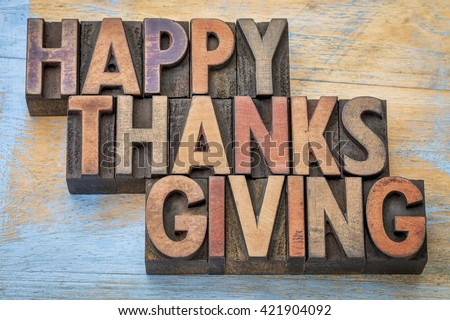 Happy Thanksgiving - a greeting card or banner in vintage letterpress wood type blocks - stock photo