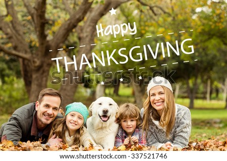 Happy thanksgiving against young family with a dog - stock photo