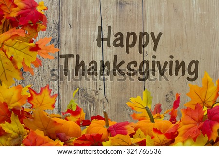 Happy Thanksgiving, Autumn Leaves and Pumpkins with grunge wood background with text Happy Thanksgiving - stock photo